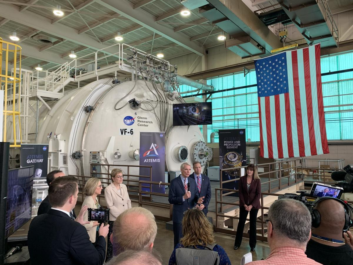 Portman and NASA Administrator Bridenstine talk in front of NASA project